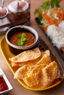 Fried wonton skin with tom yum dip